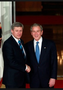 Stephen Harper and George Bush Shake Hands